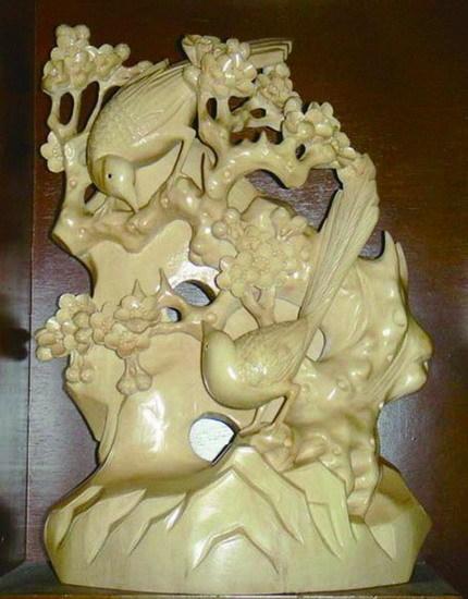 康探明雕刻的喜鹊报喜木雕