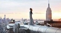 女摄影师专爬世界最著名建筑拍照